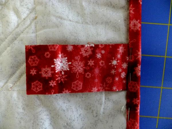 Binding covers raw edges and later hand stitched along folded edge