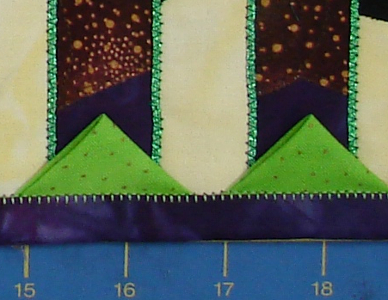 reversed blanket stitch in green to match prairie point fabric