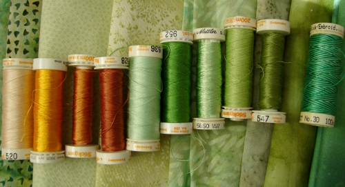thread selection of greens and golds