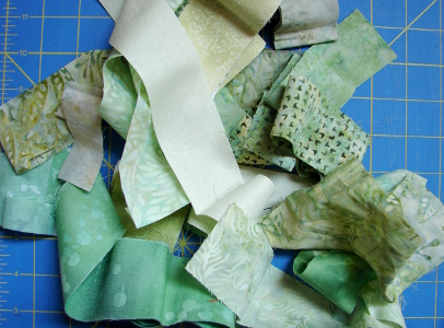strips and pieces of second color - green
