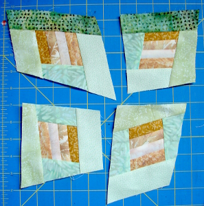 four wonky blocks all with second fabrics on all sides
