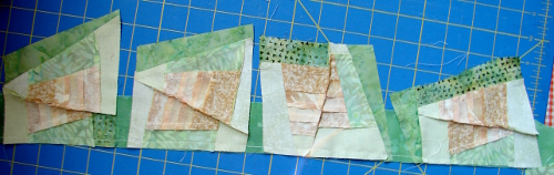 chain stitching on another strip - all four blocks stitched then cut apart
