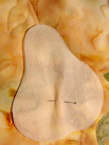 fusible backing paper used as template to quilt pear shape