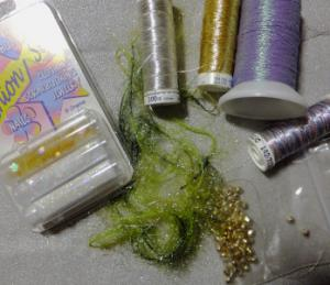 threads, beads, yarn and glitter - embellishments for stitch along