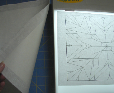 lightbox and freezer paper backed fabric