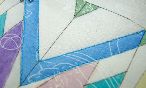 blue thread outlining section to fill