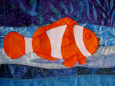 orange sections stitched using a free style satin stitch