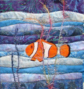 one fish block uses lighter thread for stitching around nemo, seaweed yarn added