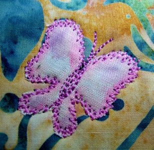 smallest butterfly edge stitched with pink thread