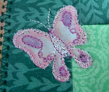 next butterfly has white edging with pink highlights