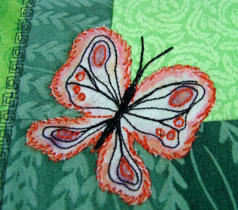 largest butterfly is decorated with orange and black thread