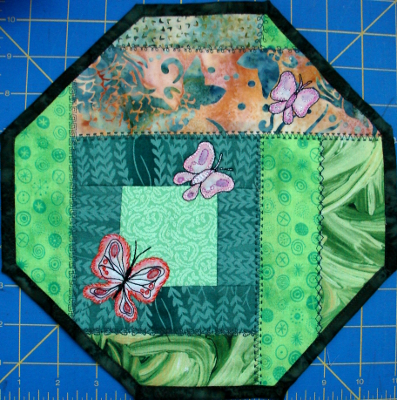 My stitch along for April  week 4 - shaped as a hexagon