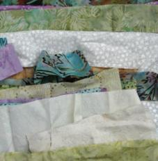 may stitch along - scraps of fabric for background