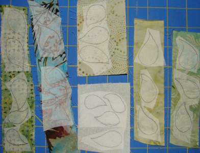 fusible webbing is pressed to wrong side of scraps