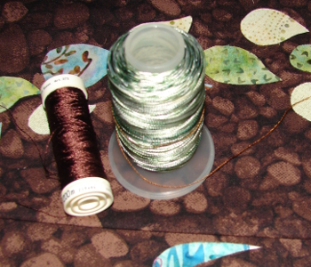 dark brown threads and variegated green