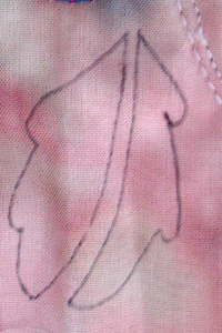 leaf drawn on back of the quilt
