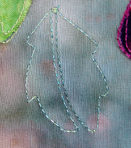 leaf stitching with sparkly thread on front