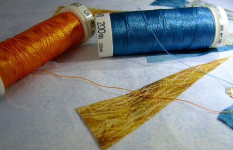 orange and blue rayon threads