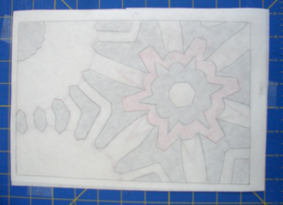 freezer paper is taped over the design ready to be drawn on