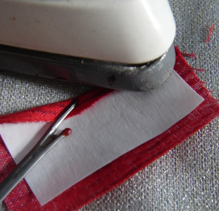 pressing seam allowance over on shiny side of freezer paper