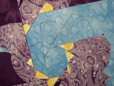 three small quilting designs drawn in center