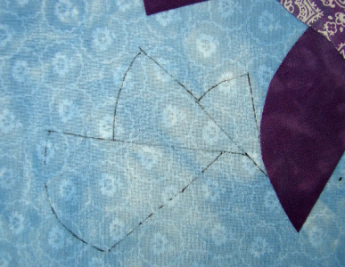 groups of three small quilting designs in corners