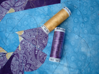 yellow silky and variegated purple threads for applique stitching