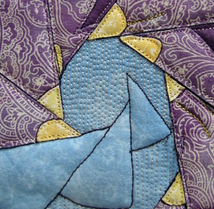 background quilting of fine lines close together