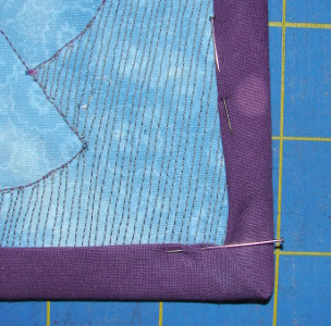 binding folded to back pinned and ready for handstitching