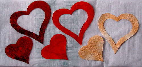 heart appliques cut out and ready to attach