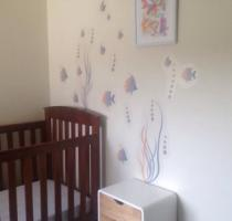 Isabella's room with fish deco on wall
