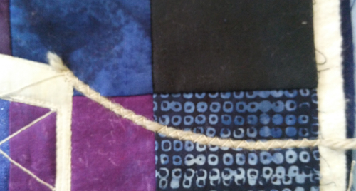 couching stitched showing extended yarn