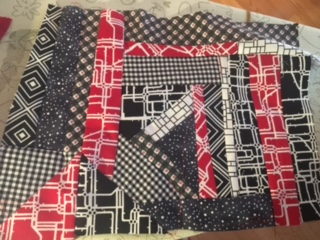 susan's black and red fabrics made into a block