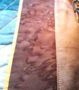 facing stitched to seam allowance