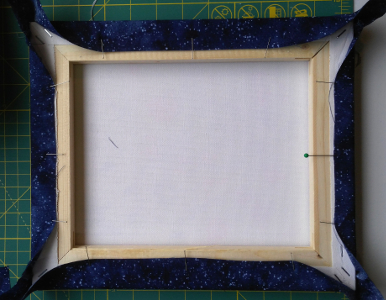 framing - pinning opposite sides to stretch fabric
