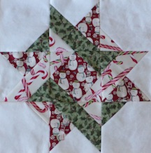 Entwined Star using fabrics of Snowman and Candy Canes