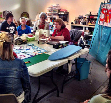 quilt week demo at Paducah with Rose Hughes