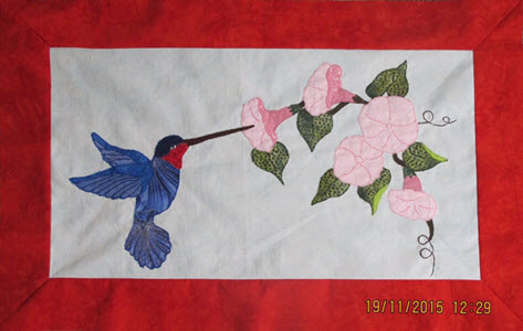 Jiliian Groom humming bird quilt appliqued without quilting