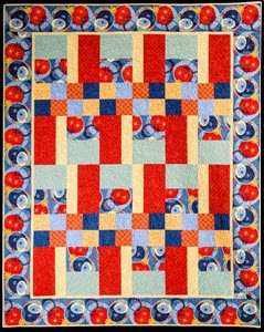 Karlene Baby Quilt in red, blue and yellow