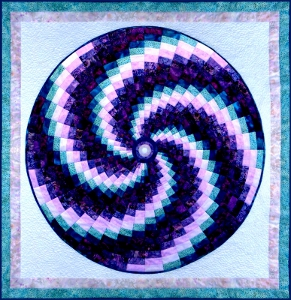 Bargello Swirl by Ruth Blanchet made using Hoffman Fabrics