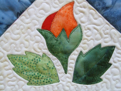 applique closeup of the rose bud and leaves
